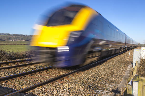 Photo of a modern train passing by at speed.